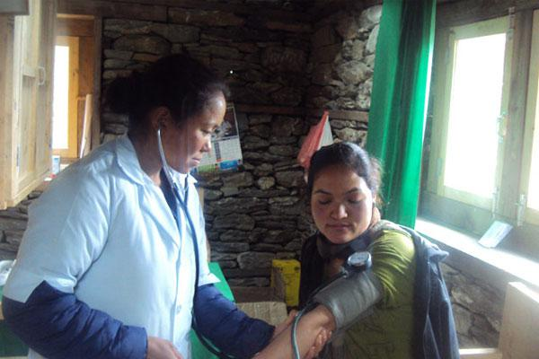 Measuring blood pressure at GSF owned clinic